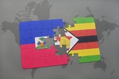 verwirren Sie mit der Staatsflagge von Haiti und von Simbabwe auf einer Weltkarte Lizenzfreie Stockfotos