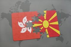 verwirren Sie mit der Staatsflagge von Hong Kong und von Macedonia auf einem Weltkartehintergrund Lizenzfreie Stockfotos