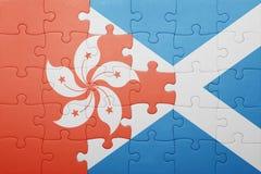 verwirren Sie mit der Staatsflagge von Hong Kong und von Schottland stockbilder