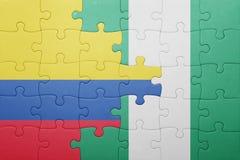 verwirren Sie mit der Staatsflagge von Kolumbien und von Nigeria lizenzfreies stockbild