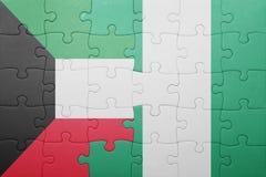 verwirren Sie mit der Staatsflagge von Kuwait und von Nigeria lizenzfreie stockbilder
