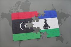 verwirren Sie mit der Staatsflagge von Libyen und von Lesotho auf einer Weltkarte Stockfoto