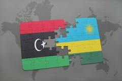verwirren Sie mit der Staatsflagge von Libyen und von Ruanda auf einer Weltkarte Stockfoto