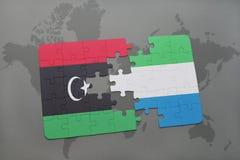verwirren Sie mit der Staatsflagge von Libyen und von Sierra Leone auf einer Weltkarte Stockbilder