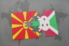verwirren Sie mit der Staatsflagge von Macedonia und von Burundi auf einer Weltkarte Lizenzfreies Stockfoto