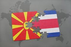 verwirren Sie mit der Staatsflagge von Macedonia und von Costa Rica auf einer Weltkarte Lizenzfreie Stockbilder