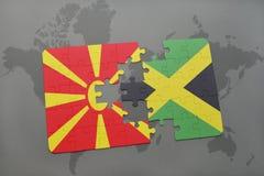 verwirren Sie mit der Staatsflagge von Macedonia und von Jamaika auf einer Weltkarte Stockbild