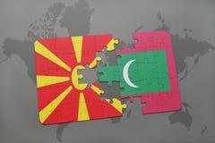 verwirren Sie mit der Staatsflagge von Macedonia und von Malediven auf einer Weltkarte Lizenzfreie Stockbilder