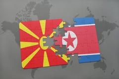 verwirren Sie mit der Staatsflagge von Macedonia und von Nordkorea auf einer Weltkarte Stockfoto