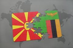 verwirren Sie mit der Staatsflagge von Macedonia und von Sambia auf einer Weltkarte Stockbilder