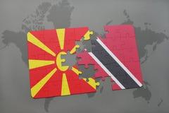verwirren Sie mit der Staatsflagge von Macedonia und von Trinidad and Tobago auf einer Weltkarte Lizenzfreies Stockfoto