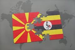 verwirren Sie mit der Staatsflagge von Macedonia und von Uganda auf einer Weltkarte Stockbilder