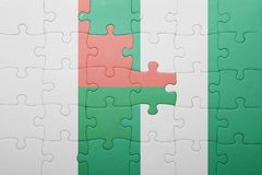 verwirren Sie mit der Staatsflagge von Madagaskar und von Nigeria Stockfoto