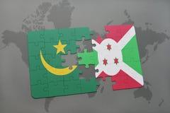 verwirren Sie mit der Staatsflagge von Mauretanien und von Burundi auf einer Weltkarte Stockfotos