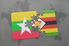 verwirren Sie mit der Staatsflagge von Myanmar und von Simbabwe auf einer Weltkarte Lizenzfreie Stockfotos