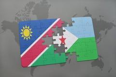 verwirren Sie mit der Staatsflagge von Namibia und von Dschibouti auf einer Weltkarte Stockbild