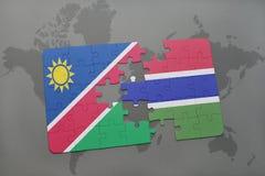 verwirren Sie mit der Staatsflagge von Namibia und von Gambia auf einer Weltkarte Lizenzfreies Stockbild