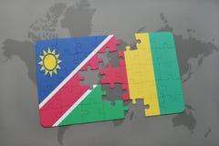verwirren Sie mit der Staatsflagge von Namibia und von Guine auf einer Weltkarte vektor abbildung