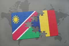 verwirren Sie mit der Staatsflagge von Namibia und von Konfetti auf einer Weltkarte Lizenzfreies Stockfoto