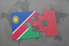 verwirren Sie mit der Staatsflagge von Namibia und von Marokko auf einer Weltkarte Lizenzfreie Stockbilder