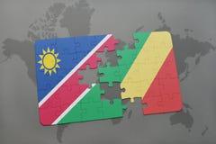 verwirren Sie mit der Staatsflagge von Namibia und von Republik Kongo auf einer Weltkarte Stockbilder
