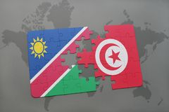 verwirren Sie mit der Staatsflagge von Namibia und von Tunesien auf einer Weltkarte Stockfotos