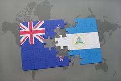 Verwirren Sie mit der Staatsflagge von Neuseeland und von Nicaragua auf einem Weltkartehintergrund Abbildung 3D Stockfotos