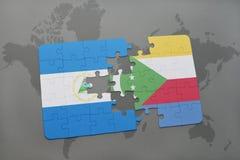 verwirren Sie mit der Staatsflagge von Nicaragua und von Comoren auf einer Weltkarte Lizenzfreie Stockfotografie