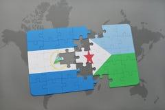 verwirren Sie mit der Staatsflagge von Nicaragua und von Dschibouti auf einer Weltkarte Stockfotos