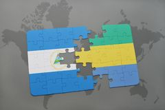 verwirren Sie mit der Staatsflagge von Nicaragua und von Gabun auf einer Weltkarte Stockbild