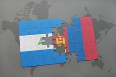 verwirren Sie mit der Staatsflagge von Nicaragua und von Mongolei auf einer Weltkarte Stockfotos