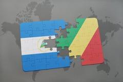 verwirren Sie mit der Staatsflagge von Nicaragua und von Republik Kongo auf einer Weltkarte Stockfoto