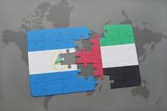 verwirren Sie mit der Staatsflagge von Nicaragua und von Vereinigten Arabischen Emiraten auf einer Weltkarte Lizenzfreie Stockfotos