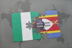 verwirren Sie mit der Staatsflagge von Nigeria und von Swasiland auf einer Weltkarte Stockfotografie