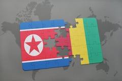 verwirren Sie mit der Staatsflagge von Nordkorea und von Guine auf einer Weltkarte vektor abbildung