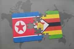 verwirren Sie mit der Staatsflagge von Nordkorea und von Simbabwe auf einer Weltkarte Stockfotos