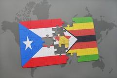 verwirren Sie mit der Staatsflagge von Puerto Rico und von Simbabwe auf einer Weltkarte Stockfotografie