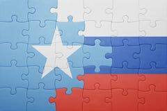 Verwirren Sie mit der Staatsflagge von Russland und von Somalia lizenzfreies stockbild