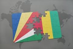 verwirren Sie mit der Staatsflagge von Seychellen und von Guine auf einer Weltkarte stock abbildung