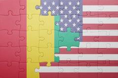 verwirren Sie mit der Staatsflagge von Staaten von Amerika und von Guine lizenzfreie stockbilder