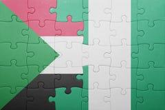 verwirren Sie mit der Staatsflagge von Sudan und von Nigeria lizenzfreies stockfoto
