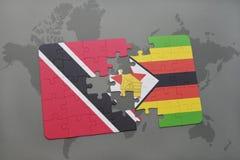 verwirren Sie mit der Staatsflagge von Trinidad and Tobago und von Simbabwe auf einer Weltkarte Lizenzfreie Stockfotos