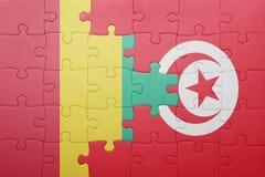 verwirren Sie mit der Staatsflagge von Tunesien und von Guine lizenzfreie stockfotografie