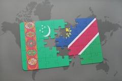 verwirren Sie mit der Staatsflagge von Turkmenistan und von Namibia auf einer Weltkarte Lizenzfreie Stockfotografie