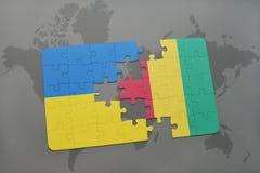 verwirren Sie mit der Staatsflagge von Ukraine und von Guine auf einer Weltkarte lizenzfreie stockbilder