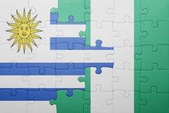 verwirren Sie mit der Staatsflagge von Uruguay und von Nigeria Stockfoto