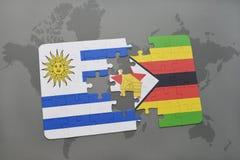 verwirren Sie mit der Staatsflagge von Uruguay und von Simbabwe auf einer Weltkarte Stockfoto