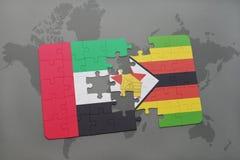 verwirren Sie mit der Staatsflagge von Vereinigten Arabischen Emiraten und von Simbabwe auf einer Weltkarte Stockfoto