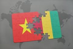 verwirren Sie mit der Staatsflagge von Vietnam und von Guine auf einer Weltkarte vektor abbildung