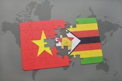 verwirren Sie mit der Staatsflagge von Vietnam und von Simbabwe auf einer Weltkarte Stockfoto